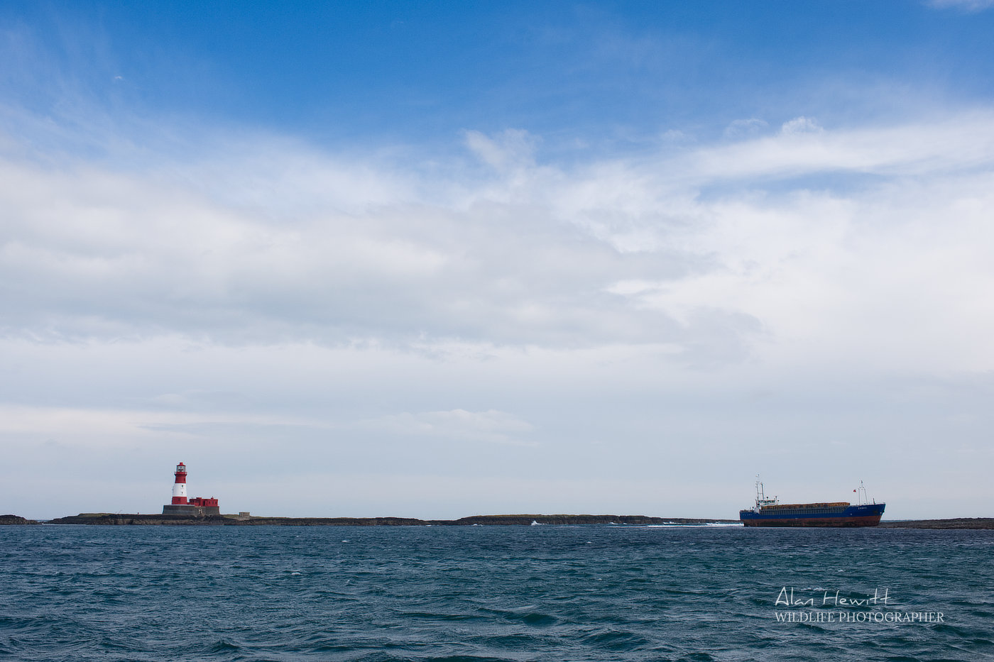 MV Danio Grounded on the Blue Caps with Longstone Lighthouse in proximity, Farne Islands. Alan Hewitt Photography.